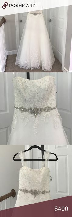 New with Tags David's Bridal Wedding Dress Size 4 David's Bridal Wedding Dress Style WG3007 in Ivory. Size 4. Never worn or altered. Still has tags. Lace bodice and train with beads. Buttons down back. Optional lace sleeves. Originally $800. Asking $400. David's Bridal Dresses Wedding
