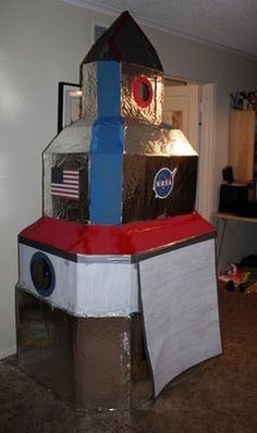 Filth Wizardry: Giant cardboard rocket ship - would be cute in our playroom/montessori room although it's not exactly Montessori material....mehhhh - it's too fun to pass up the idea!  Perhaps it could be a reading nook!