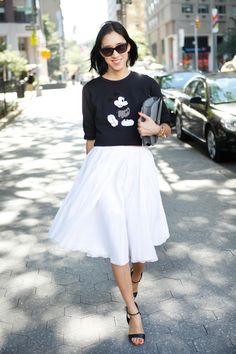 Eva Chen in a Marc Jacobs sweater, Jil Sander skirt, Valentino sunglasses, Gianvito Rossi pumps and Celine purse.