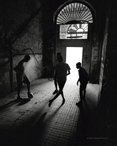 havana | Tumblr vision.dance (Dan Powers) Boys playing football (soccer) in the decaying lobby of an old building in Havana