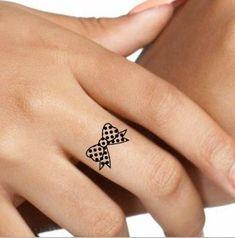 Polka dot bow tattoo