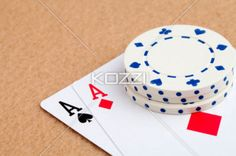 casino token on aces - Casino token on top of a pair of aces.