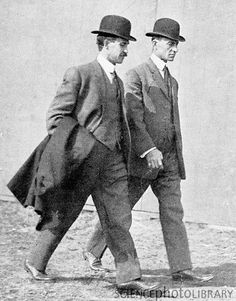 The Wright Brothers, Orville (1871-1948), left, and Wilbur (1867-1912), right, American aviation pioneers. On 17 December 1903 at 10.23am, their powered aircraft, the Wright Flyer, made its first flight with Orville at the controls.
