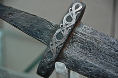 Viking sword (detail) - 9th/10th century. I love how the inlaid silver, has survived all these years!