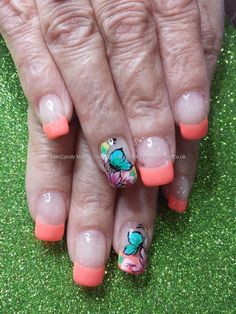 Orange gel tips with one stroke flower and butterfly nail art