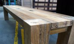 wood bench with notched post legs. i wouldn't mind a kitchen table like this if it were wider.