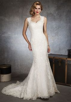 Gown features lace.