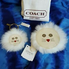 """Coach Lion Coin Purse and keychain fob Bundle! Nwt This lovely listing is for a bundle of Coach items! One lovely white animal Lion coin purse and keychain fob! Both are brand new unused with tags and a dust bag and cleaning card insturctions! Keychain fob f62983 and coin purse 4.25"""" and f62845. The mink fur is perfect on both items and the white patent leather has details like wiskers and a pink nose! Snap button eyes and these are perfect for that coach collector. Other Coach items listed…"""