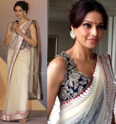 Bipasha was looking gorgeous wearing a white Anamika Khanna sari with an embroidered blue blouse and Amrapali jewelry.