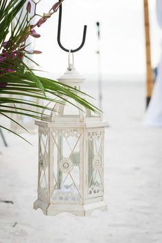 Beach Ceremony with White Lantern - Vibrant Beach Wedding at Sirata Beach Resort - Photo by Limelight Photography - click pin for more - www.orangeblossombride.com