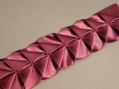 Another Way to Make Pleated-Ribbon Trim - Threads.   GREAT tutorial using paper and ribbon to illustrate.