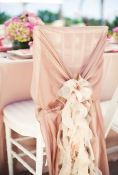 These blush chair covers are gorgeous for a backyard wedding shower!