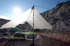 The benefits of trekking poles.  Hyperlite Mountain Gear Echo II Tarp, pitched with trekking poles to save the weight of dedicated tent poles.