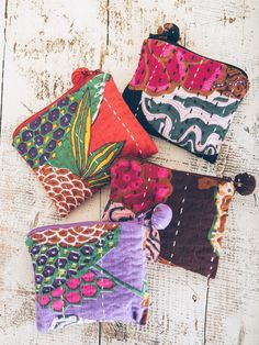 """This cute soft fabric pouch is made from a traditional quilted Indian fabric called Kantha. Features a zippered pom-pom closure at top. Made of 100% cotton. Measures 4"""" H x 5"""" W. Created by Blue Mango"""
