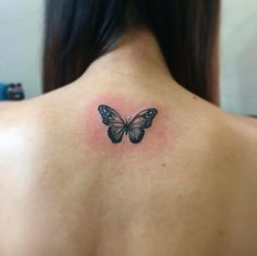Tiny Butterfly Tattoo on Back by Nathan Agulto