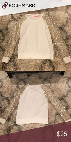 Pink lily boutique sequin long sleeve top White with gold sequin sleeves.