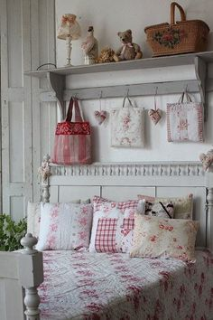 Love these white and red linens and quilt. this would be a lovely little girl's room or guest bedroom.