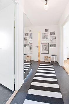 Wall art in hallway | via Bjurfors.se
