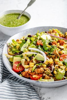 Hearty and delicious chicken taco salad loaded with taco seasoned ground chicken, juicy tomatoes, fresh corn, savory cheese and a wonderful cilantro vinaigrette. This protein-packed chicken taco salad recipe makes the perfect healthy lunch or side dish for your next BBQ! #salad #tacosalad #chicken #chickensalad #healthylunch #bbq #potluck #picnic Taco Salad Recipes, Mexican Food Recipes, Dinner Recipes, Healthy Recipes, Healthy Food, Healthy Taco Salad Recipe, Tasty Meals, Healthy Eating, Ground Chicken Tacos