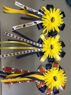 Spirit day or homecoming pin for the mom's of senior football players. Buy the flowers in a bunch and add a football to the middle of flower. Decorate with school color ribbon and add a pin to back. Football Banquet, Football Cheer, Football And Basketball, Football Is Life, School Football, Football Players, Basketball Stuff, Softball Stuff, Soccer