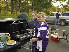 Tailgating!! :)    Grilling out of the back of a truck. Awesome.