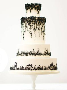 Enchanted Forest - Inspired by the drawings of Jan Pienowski and fairytales, this cake is striking in monochrome. It's a work of art, displaying Rosalind Miller's background as an artist and designer. Voted Best Wedding Cake Designer in the 2012 Wedding Industry Awards, nobody does whimsy quite as magically as Miller.