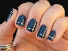 Gold Finger Katy from Nailed It used striping tape to amplify her plain black mani. If you're feeling extra creative, add extra lines of striping tape to an accent nail, or paint the bottom half of your nails a different color like white or nude.