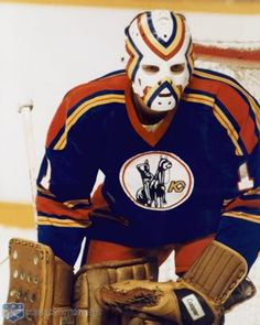 Denis Herron's warpaint mask stripes just meshed well with the Kansas City Scouts uniform, even if it did look partly like a rainbow mustache. Pro Hockey, Bruins Hockey, Hockey Goalie, Hockey Teams, Hockey Players, Hockey Stuff, Stars Hockey, Scout Uniform, Goalie Mask