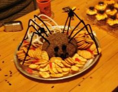 Easy to make spider cheeseball.  See more Halloween appetizers and party ideas at one-stop-party-ideas.com
