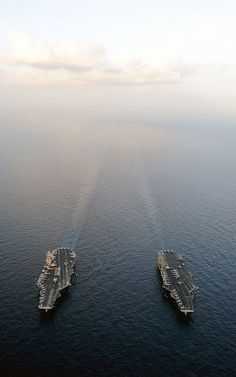 The Nimitz-class aircraft carriers USS Abraham Lincoln (CVN 72) and USS John C. Stennis (CVN 74) join for a turnover of responsibility in the Arabian Sea.