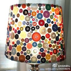 buttons on lamp - I think this is button printed paper on the lampshade.  But cute, and a good inspiration to use all those old buttons!
