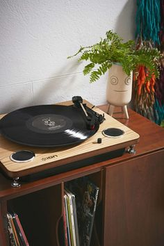 This natural wood vinyl record player with built-in speakers sounds just as pretty as it looks. Grab it here: Ion Pro Sound USB Vinyl Record Player, $90