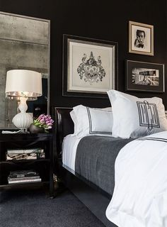 Very masculine black + white bedroom.  I love the metallic interior of the lampshade on the bedside table lamp.