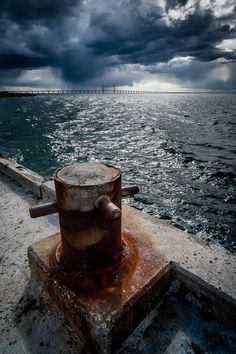 Storm clouds over Öresund Bridge by Magnus Larsson, via 500px