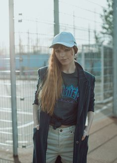 Sporty Berlin street style with pinstripe coat and Thrasher t-shirt, fashion photography urban Berlin