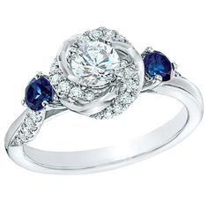 Diamond and blue sapphire swirl ring in white gold by Vera Wang Love.