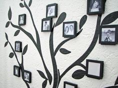 Combine peel-and-stick vinyl with black frames to make a wall-sized family tree #DIY