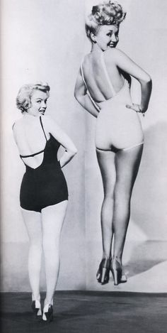 WOW, rare...Marilyn  stands next to Betty Grable's famous pin-up image c. 1950's