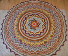 This round blanket was crocheted by me. Crochet mandala blanket is made of fine wool yarn. Very large, warm and cosy!  The blanket measures in