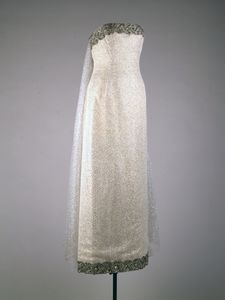 Maker: Oleg Cassini (American, b. France, 1913-2006)  Date(s) of Materials: 1962   Historical Note: This dress was worn by Jacqueline Kennedy to the state dinner honoring President Felix Houphouet-Boigny of the Ivory Coast, the White House, Washington, DC, May 22, 1962.