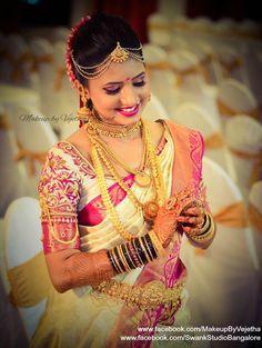 Our gorgeous bride Arpitha looks stunning for her muhurtam. Makeup and hairstyle by Vejetha for Swank Studio. Photo credit: Manish Ananda. Pink lips. Maang tikka. Bridal jewelry. Bridal hair. Silk sari. Bridal Saree Blouse Design. Indian Bridal Makeup. Indian Bride. Gold Jewellery. Statement Blouse. Tamil bride. Telugu bride. Kannada bride. Hindu bride. Malayalee bride. Find us at https://www.facebook.com/SwankStudioBangalore