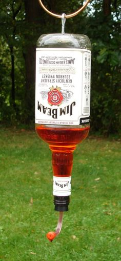 recycled bottle humming bird feeder - not sure whether this goes on funny or DIY.  But it does make me smile.