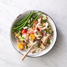 Tuna-Quinoa Toss | A whole-grain protein bowl is the perfect solution for when lunch needs to be quick—and tasty, filling, and healthy. Cook quinoa ahead of time (or buy precooked, available in pouches on the grain aisle as well as in the freezer) and assemble in the morning or when ready to eat. Quinoa is not only gluten-free but it also offers almost double the protein, fiber, iron, and calcium compared to other gluten-free grains (though you can substitute any other whole grain).
