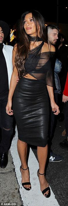 Daring darling: Nicole definitely ensured all eyes were on her as she showed off her fabulous figure in the daring outfit