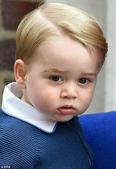 Prince George looked bewildered as photographers take hundreds of pictures
