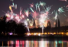 GERMANY: Bursts of colour fill the sky over the Maschsee lake in Hanover as the celebrations continued despite the terror threat in Munich