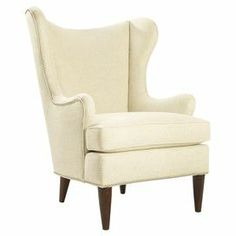 "Beautifully blending modern and classic appeal, this wood-framed arm chair showcases a wingback silhouette and nailhead trim.   Product: ChairConstruction Material: Wood and linenColor: Barley and espressoFeatures:  Made in the USAPewter nailhead trim 19.5"" Seat height23"" Seat depth25"" Arm heightDimensions: 43.5"" H x 34"" W x 37.5"" D Assembly: Assembly required"