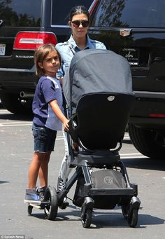 Moving on: Kourtney Kardashian looked sombre as she emerged in Los Angeles with her eldest...