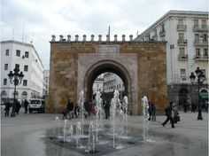 S1E4: Bab el Bhar in Tunis, Tunisia. Also called the Porte de France or French Gate, is a huge freestanding arch that was the medina's eastern gateway until the surrounding walls were demolished by the French to create Place de la Victoire.