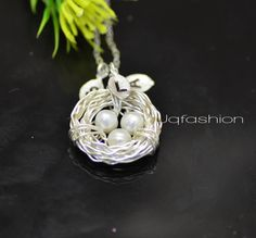 THREE Initial Bird Nest Necklace, Personalized,  Bird Nest, Mothers Jewelry, Mother Gift, Mothers Day. $32.50, via Etsy.